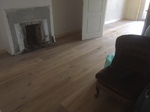 Sitting room with wood flooring